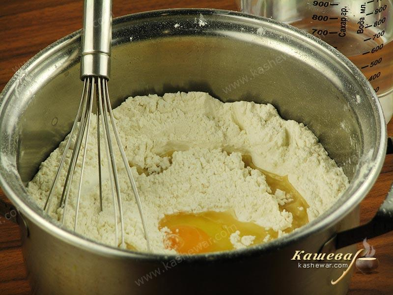 Drive eggs into the sifted flour