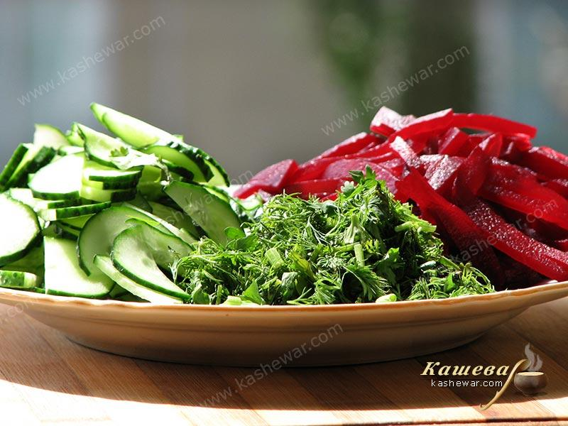 Cutting vegetables and herbs for borsch