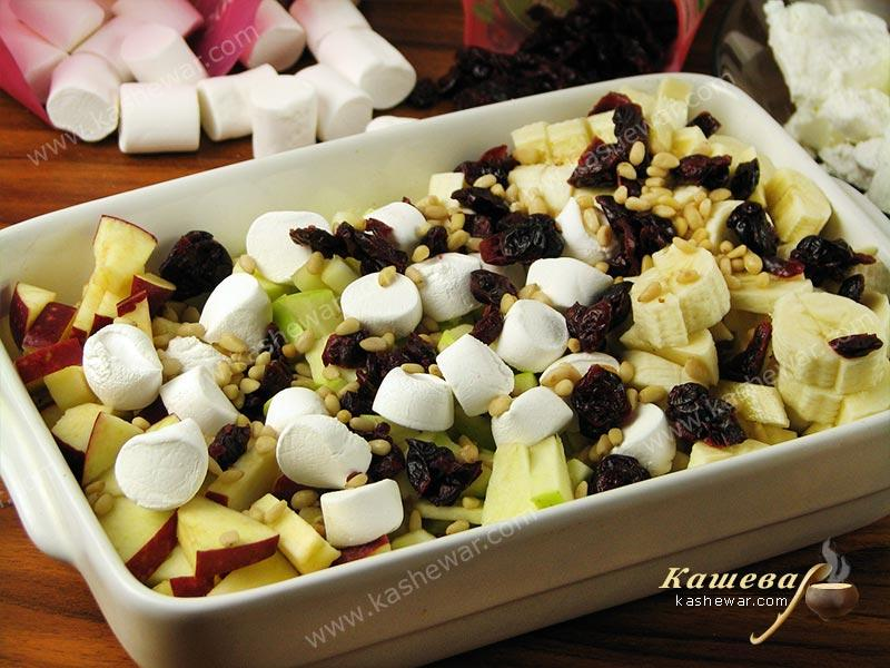 Apples and bananas mixed with cranberries and marshmallows