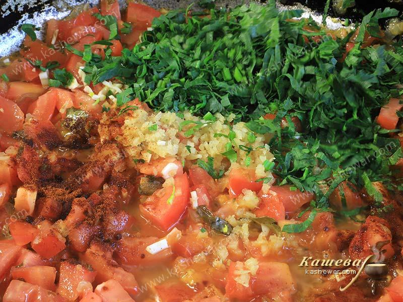 Finely chopped tomatoes, herbs and spices in a pan