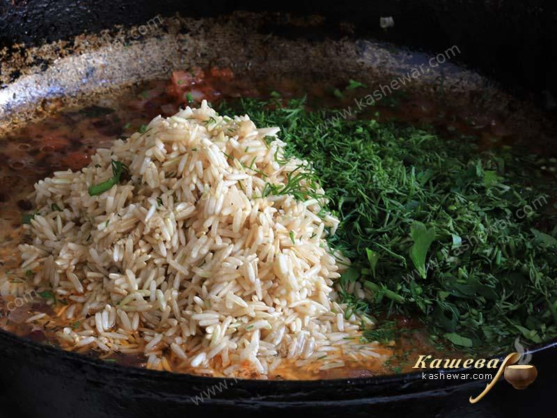 Rice with vegetables and herbs in a pan