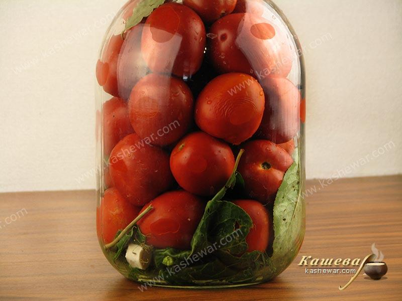 Tomatoes in jars