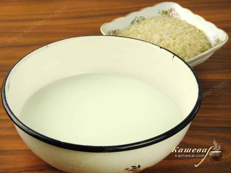 Mix water with milk, boil and pour rice