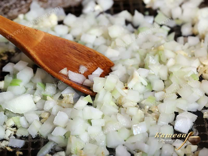 Finely chopped onion in a skillet