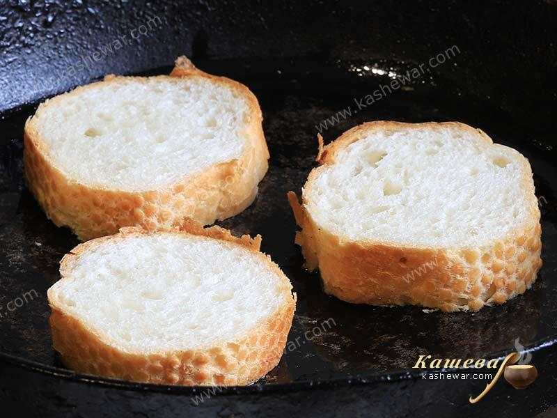 Chopped baguette in a frying pan