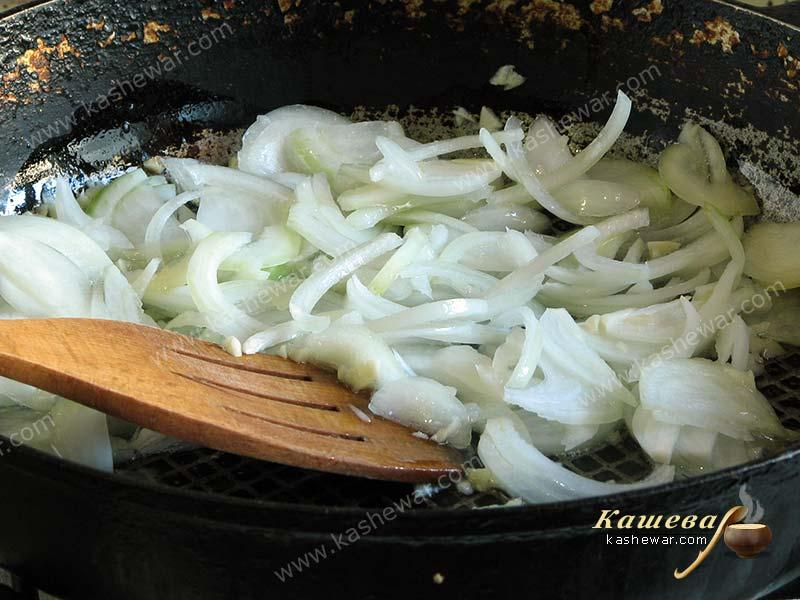 Chopped onions in a frying pan