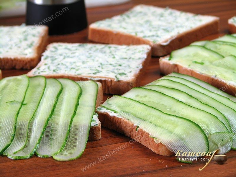 Put the cucumbers on the butter