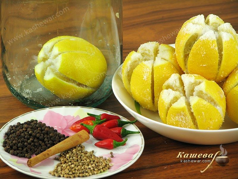 Pour salt into the cuts of the lemons and put in jars