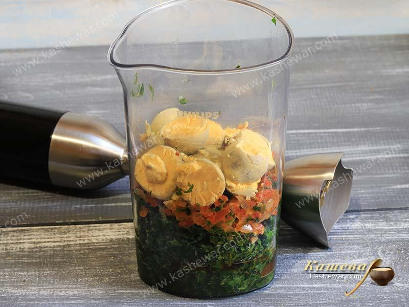 Spinach, frying and eggs in a glass