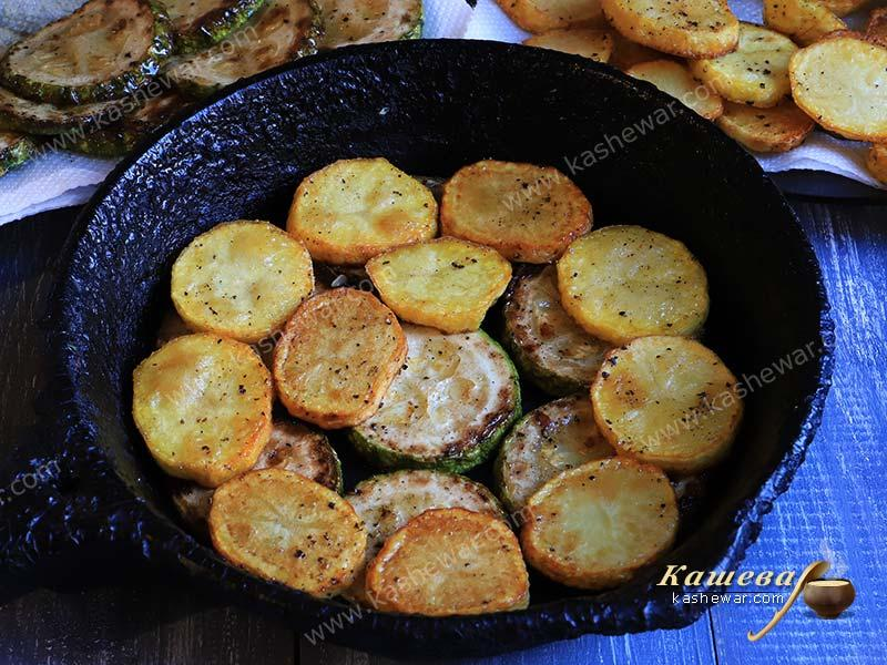 Potatoes with zucchini in a pan