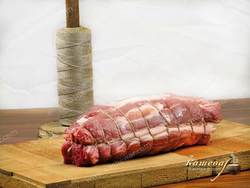 Tying a pork neck